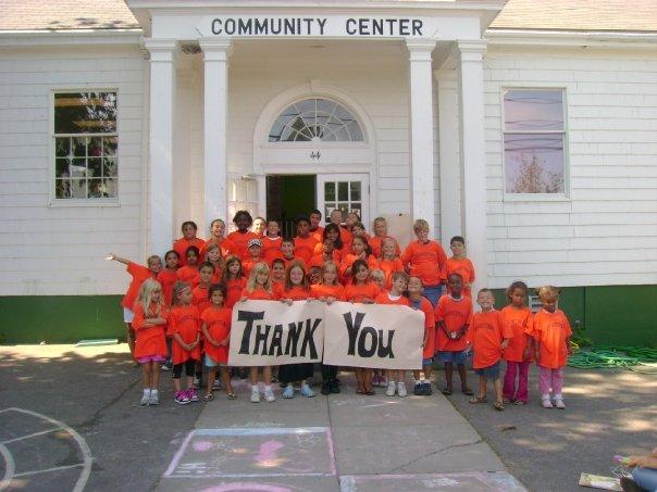 "Kids Wearing Orange Shirts Holding a ""Thank You"" Sign"